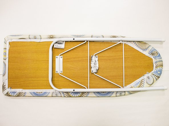 Place the ironing board face down on a flat, stable surface.