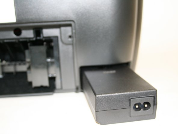Insert adapter into the bottom-right slot behind the printer with the adapter end facing outward.
