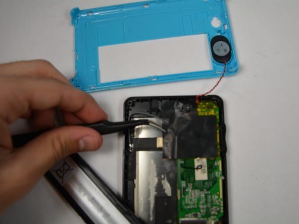 Use tweezers to remove the black tape that is attached to the motherboard.