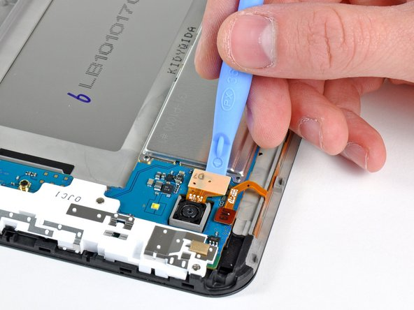 Use the edge of a plastic opening tool to pry the rear camera connector up from its socket on the motherboard.