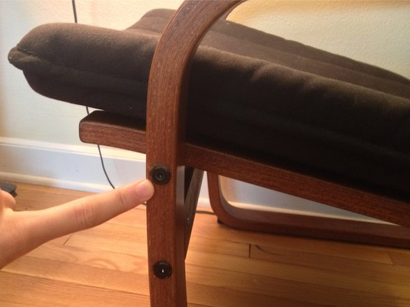 Remove the same bolts on the opposite side of the chair.