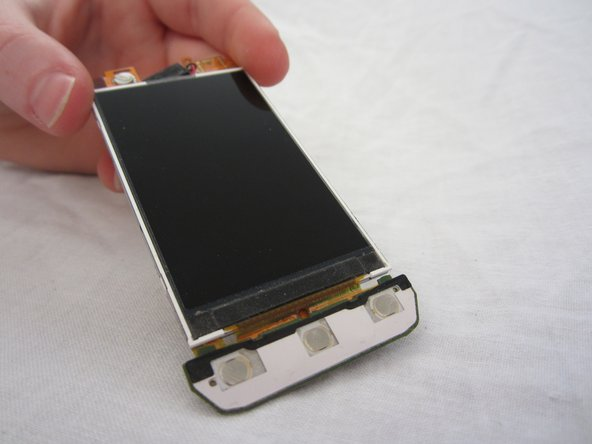 Remove the LCD. Be careful, the LCD screen is fragile.