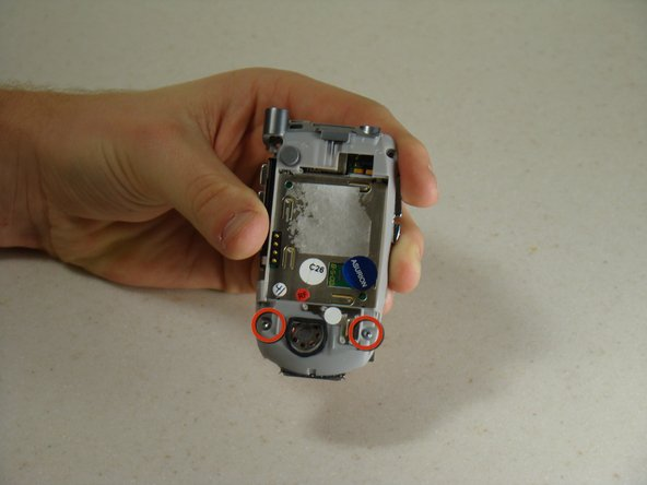 Rotate the phone around so that you are looking at the battery cavity.