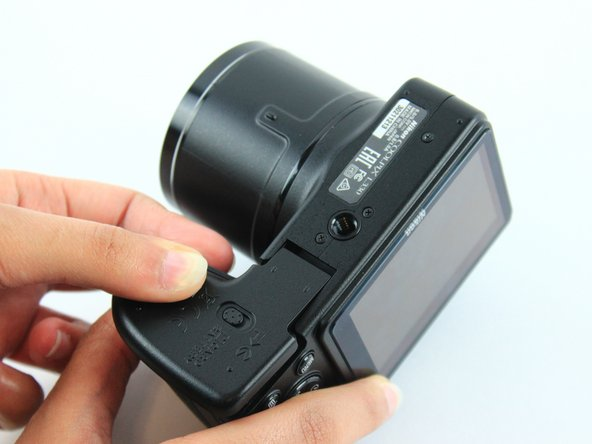 Image 2/3: The inner battery housing has orientation stickers to show the way in which the batteries should be placed.