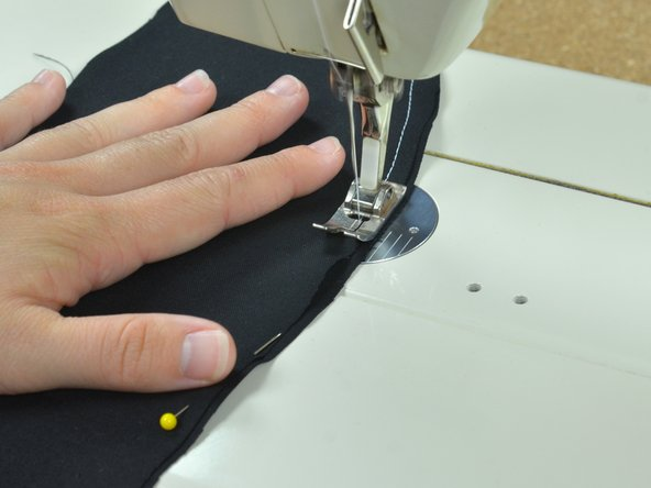 Image 3/3: Stop before you reach each pin. Pull the pins out, being careful not to misalign the fabric.