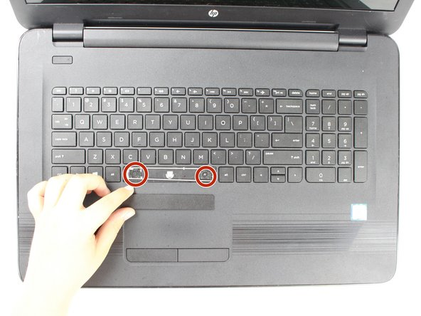 The lower edge of the keyboard has two plastic notches on either side.