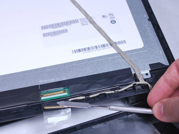 Disconnect the display cable by first taking off the tape using a metal spudger and then pulling on the black tab.