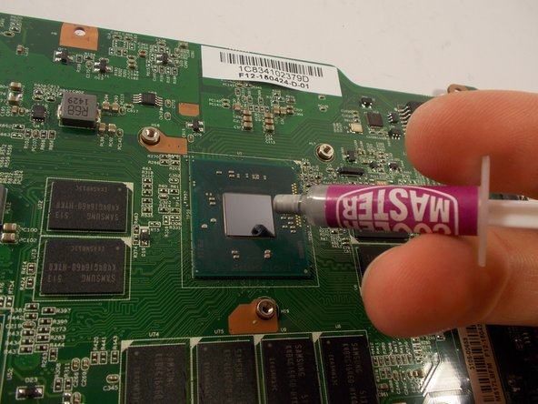 Apply a small drop of thermal compound to the processor.