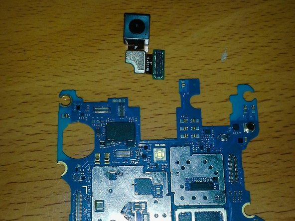 Set the motherboard off to the side in a safe spot until you reassemble your phone.