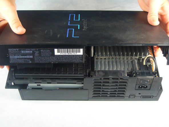 Flip the PlayStation 2 back to its original upside position.