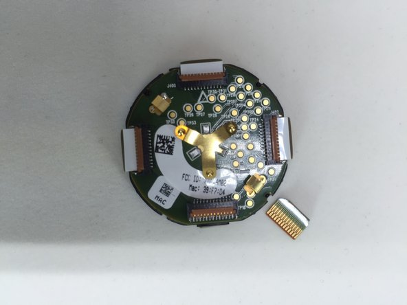 Image 1/3: The back of the PCB immediately shows a bunch of testing points which are labelled on the silkscreen layer with TPXX.