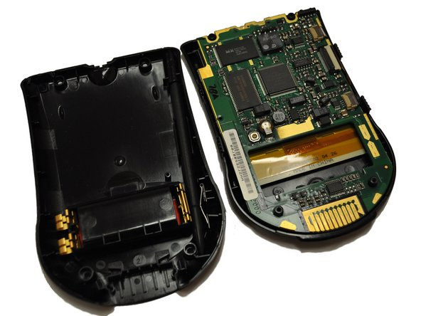 Once the four screws are removed, you are able to remove the back and front cover from the interior parts of the device.