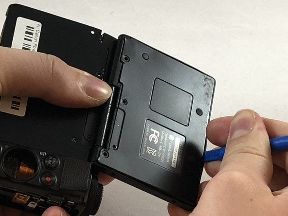 Using the plastic opening tool, pry back the backplate from the front of the screen.