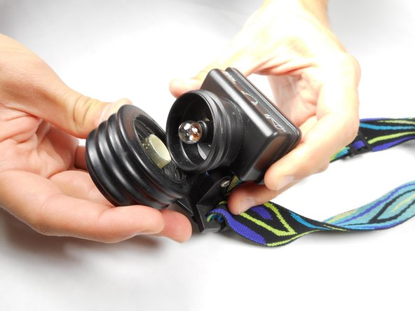 Remove the lens piece by firmly pulling it away from the battery housing.