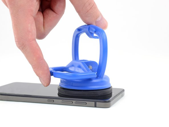 After positioning the suction cup, gently press down, and then close the handle to securely fasten the suction cup to the display surface.