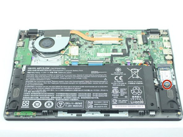 Remove the 3.6 mm  Phillips screw that secures the SSD in place.