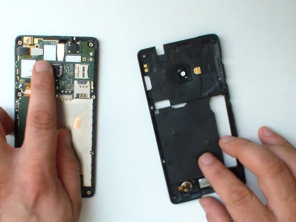 With a plastic opening tool separate the back cover from the middle frame.