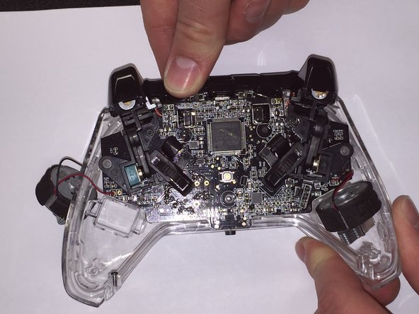 Lift circuit board off of controller.
