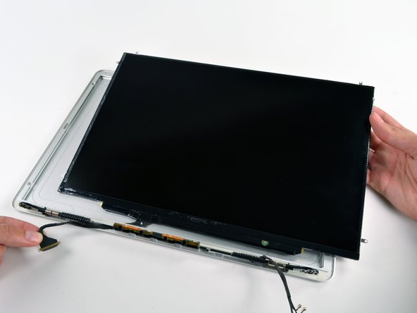 Pull the LCD toward the top edge of the display assembly to slide the inverter board along its lower edge out of the recess in the aluminum display assembly.