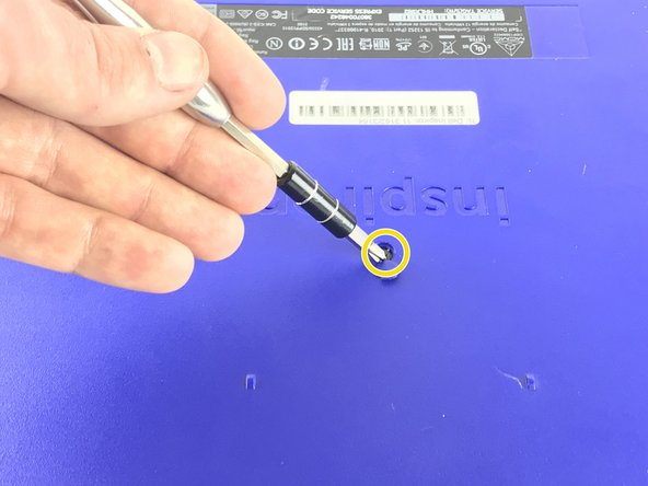 Use your screw driver to remove the plastic cover  in the center of the laptop.