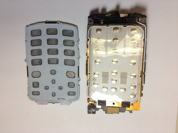 Here is the rubber keyboard and the dome switch circuit board. A quick inspection of these elements can reveal keypad malfunctions. Look for dirt or debris that do not belong there.