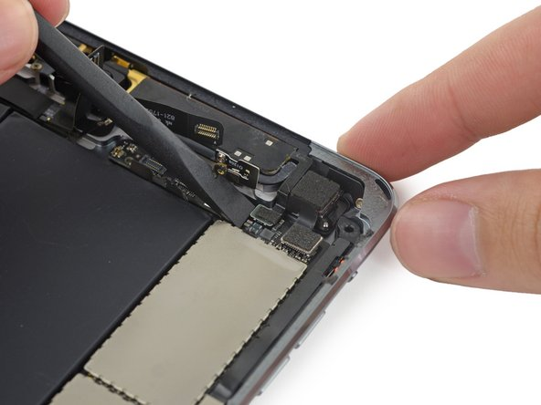 Image 1/3: Fold the cable up out of the way of the logic board.