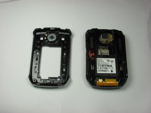 Replace the inner back cover by snapping the top of the cover against the phone. Push down on the bottom of the inner back cover to snap the entire cover into place.