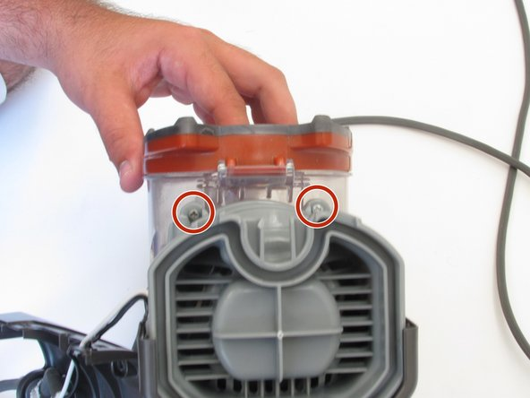 Locate  two  screws above the fan compartment and remove the screws with a Phillips #2 screwdriver.