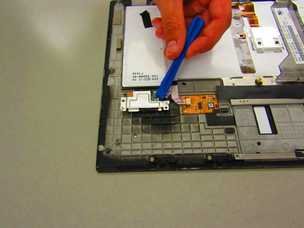 Remove the ribbon cable connected to the board.