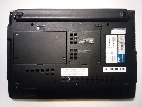 Flip the laptop over onto the back.