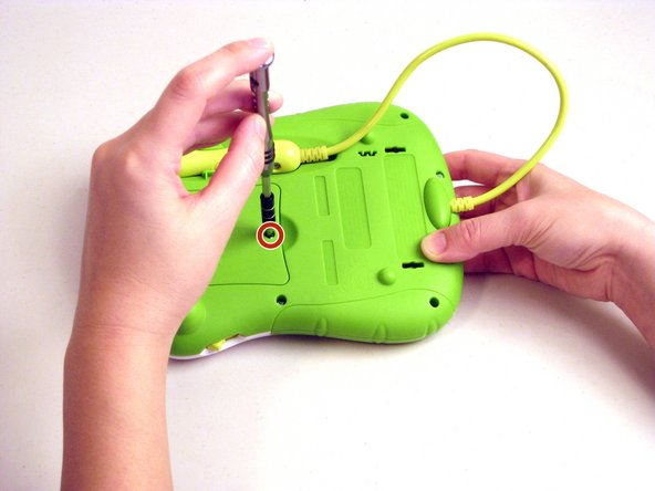 Use a Phillips head screwdriver to remove the screw from the battery compartment on the back of the toy.