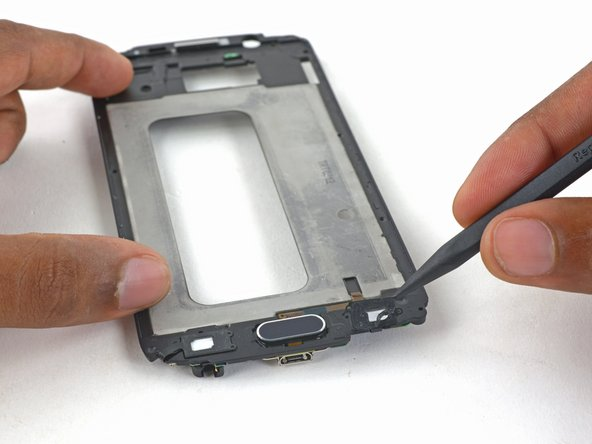 Image 2/3: Gently lift the LED cable off the display frame.