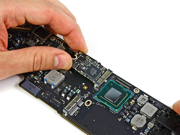 Image 1/2: Remove the AirPort/Bluetooth board from the logic board.