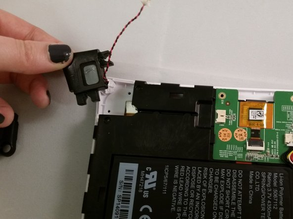 Image 2/2: The circuit board should still be loose to remove the speaker.