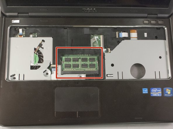 Image 1/3: Using both thumbs, push out on the small locking  arms, located on each side of the RAM. If done correctly, RAM will pop up to an accessible angle.