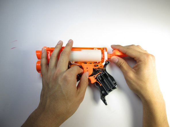 Remove the firing trigger by grabbing the trigger with your fingers and pulling it up and out.