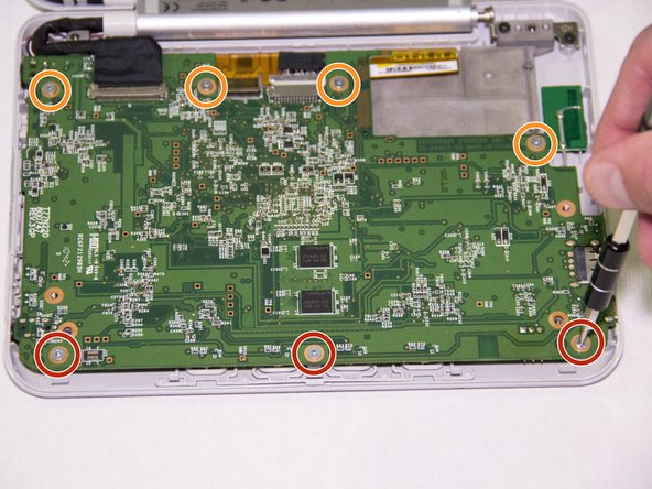 Image 2/2: Using your J0 Phillips head screwdriver, remove the four 3mm screws from the top of the motherboard.