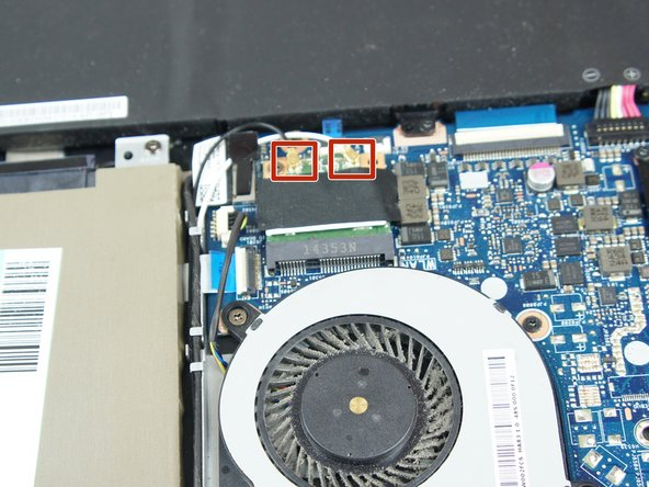 Disconnect the black and white wires that provide power and data transfer to the Wi-Fi chip.