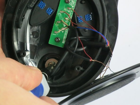Image 1/1: You may need to pull the wire with the knot out of the way of the screw.