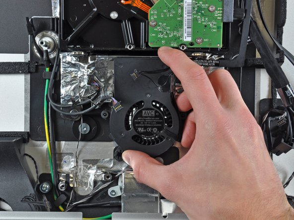 Remove the hard drive fan from the outer case.