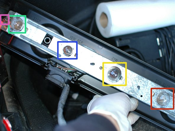 There are five bulbs in each tail light housing. They are as follows: