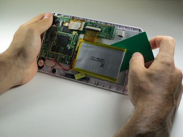 Use a credit card, or other thin object, to separate the battery from the screen.