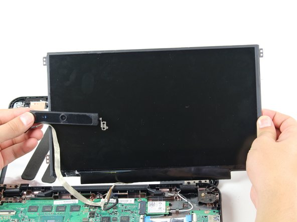 Image 2/2: Slowly peel back the camera adhesive cable from the metal panel to fully remove the screen and camera.