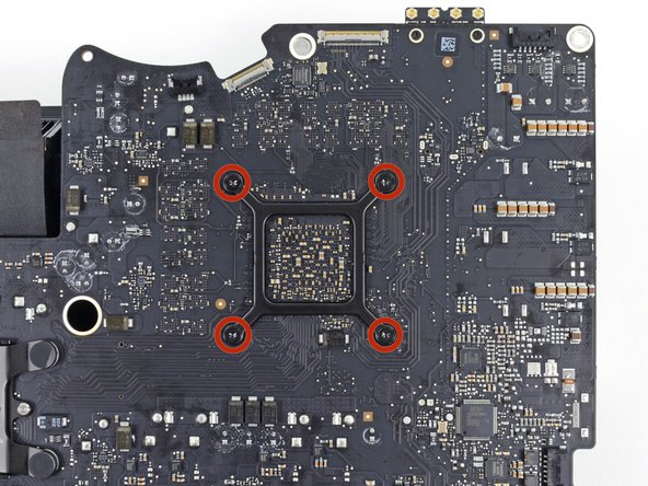 Remove the four 7.5 mm T8 screws from behind the GPU on the logic board.