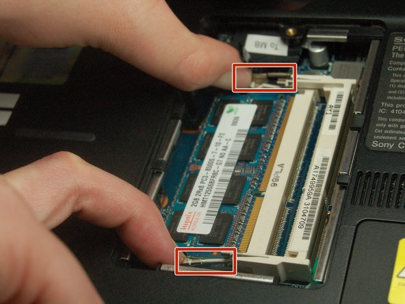In order to remove the secondary RAM, use the same outward pressure on the locks.