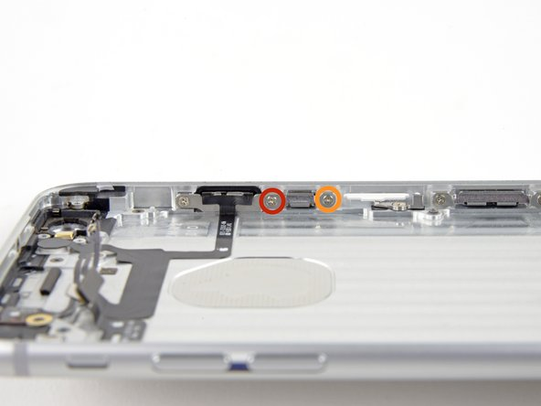 Remove the following screws securing the power button cable bracket to the inner edge of the rear case: