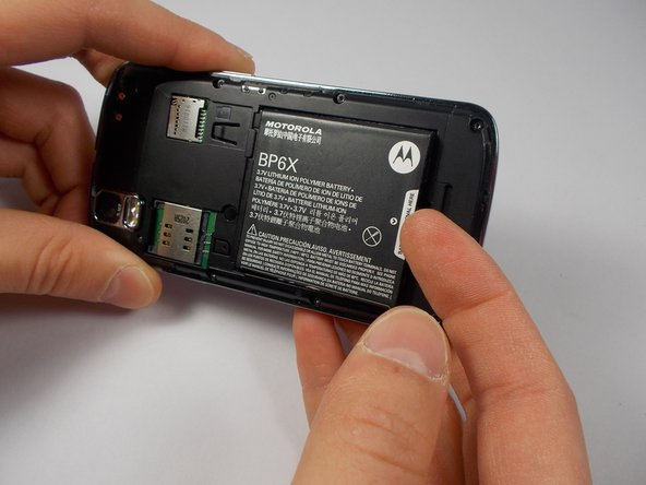 Remove the battery using the thumb tab.