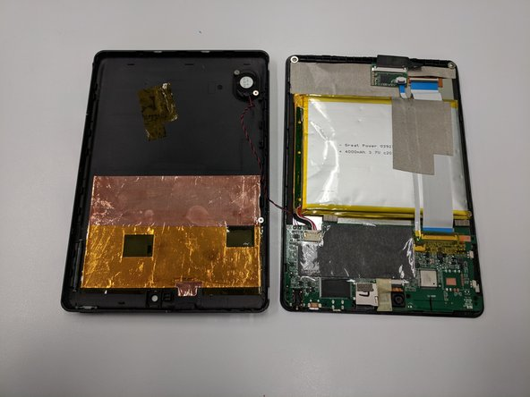 Being cautious of the wire connecting the speaker and the motherboard, place the front and back portion of the tablet close in proximity.