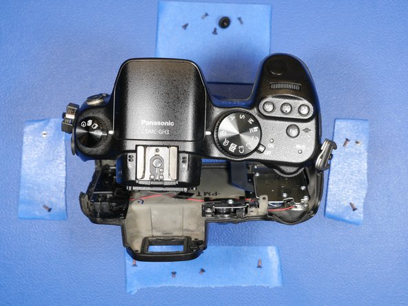 Rock the rear shell of the camera from left side to the right side to aid in the removal of the rear LCD shell assembly.