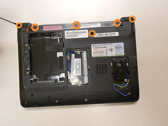 Remove all 11 of the screw shown on the bottom of the lap top using the specified screw driver.